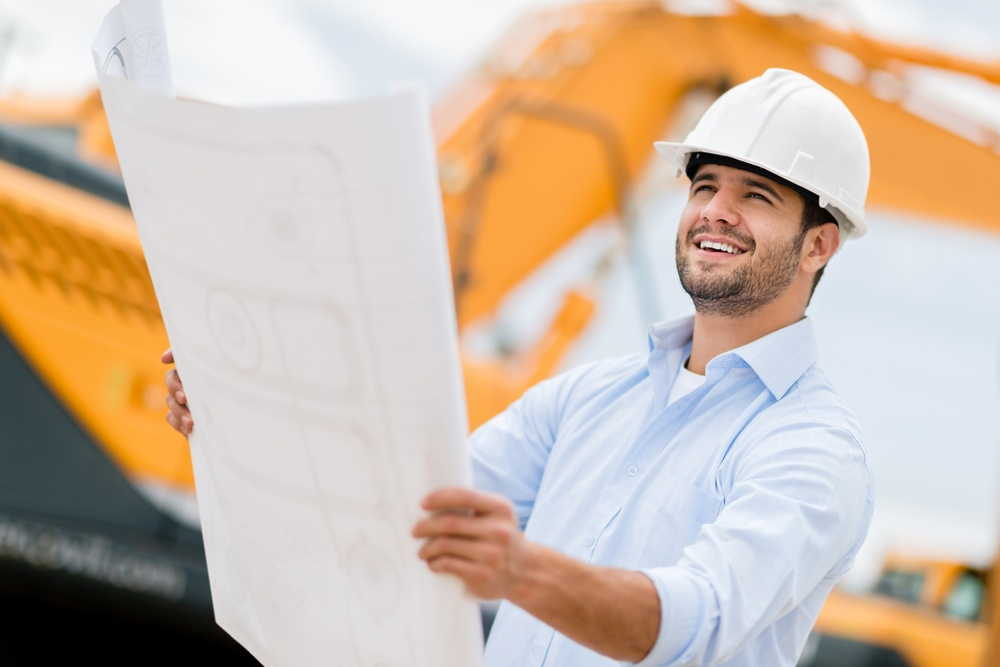 Architect looking at blueprints in a building site